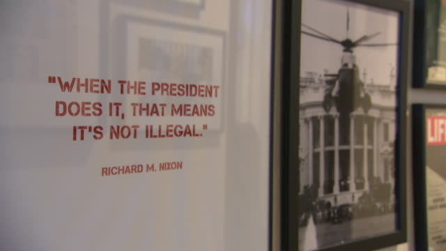 interior shots of quote in a picture frame hung on a wall in the scandal room at the water gate hotel saying when the president does it that means... - watergate scandal stock videos & royalty-free footage