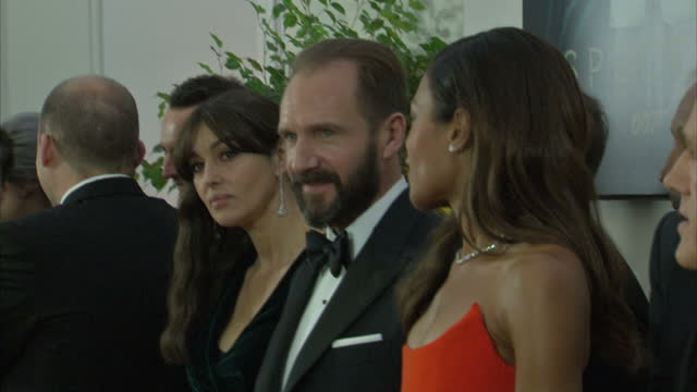 interior shots of ralph fiennes, monica bellucci and naomie harris waiting in line to meet the royal family at the royal world premiere of 'spectre'... - レイフ・ファインズ点の映像素材/bロール