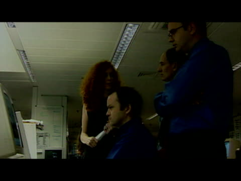 interior shots of rebekah wade in news of the world office looking through proofs on computer screen with andy coulson and others rebekah brooks... - news of the world stock-videos und b-roll-filmmaterial