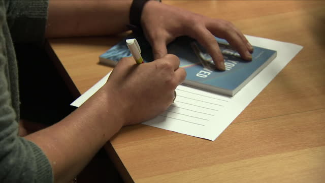 interior shots of relatives of dr goodall signing forms on 10 may 2018 in basel switzerland - euthanasia stock videos & royalty-free footage