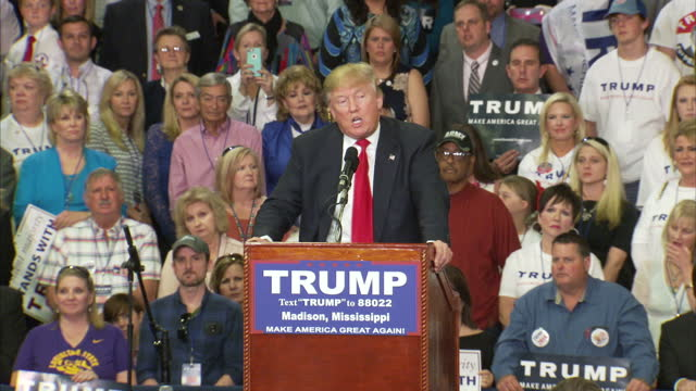 stockvideo's en b-roll-footage met interior shots of republican candidate donald trump speaking during a rally talking about his business success and saying that if he was elected to... - 2016