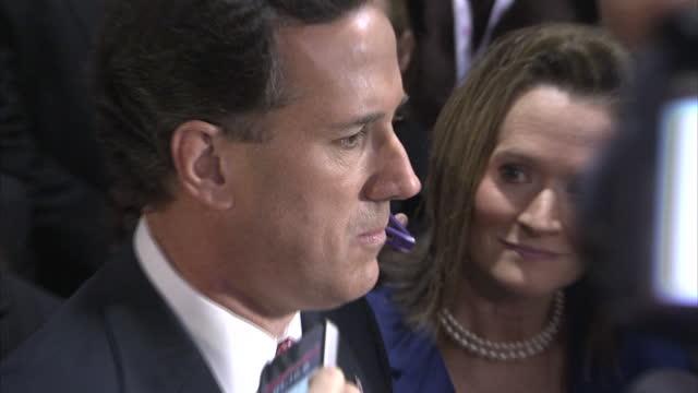 stockvideo's en b-roll-footage met interior shots of republican senator of pennsylvania rick santoum being interviewed by reporters at the republican gop primary debate in south... - congreslid