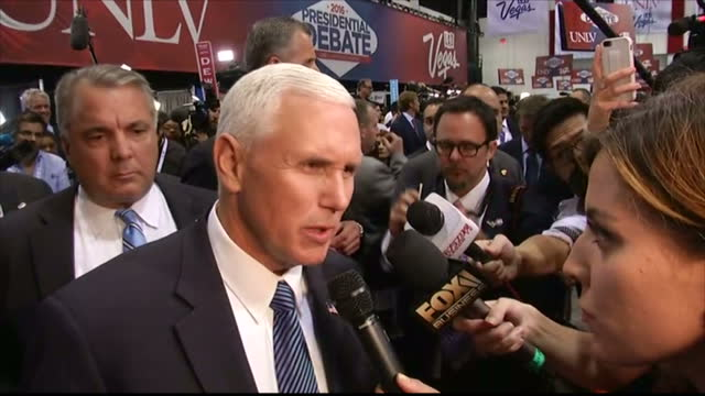 Interior shots of Republican Vice Presidential Candidate Mike Pence speaking to reporters about how he feels the third presidential debate went for...