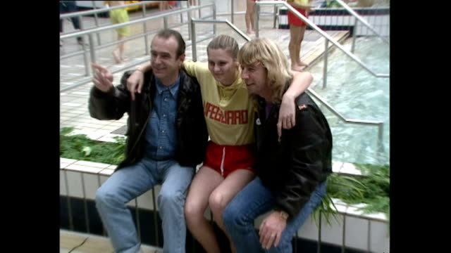 interior shots of rick parfitt and francis rossi posing in front of a swimming pool with a young female lifeguard on october 11 1990 in minehead... - minehead stock videos & royalty-free footage