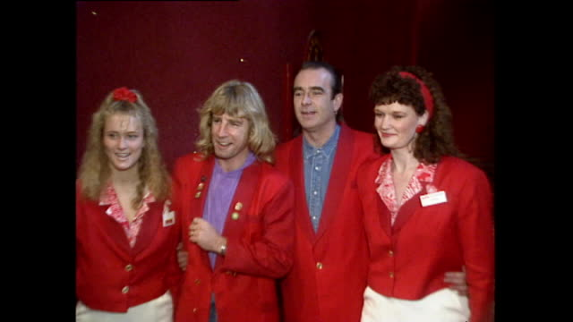 interior shots of rick parfitt and francis rossi posing in front of cameras wearing butlins red coats on their visit back to the place where they... - butlins stock videos and b-roll footage