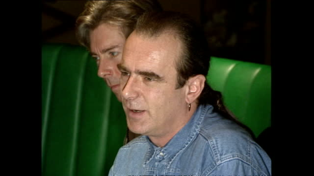 interior shots of rick parfitt francis rossi walking into bar at butlins and sit down around table to talk to press on october 11 1990 in minehead... - minehead stock videos & royalty-free footage