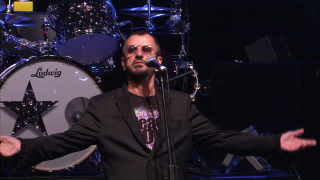 interior shots of ringo starr announcing his new tour with his all star band arriving sitting at drums speaking at microphone on stage posing with... - ringo starr stock videos and b-roll footage