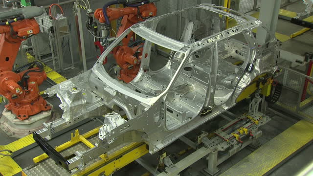 interior shots of robots on an assembly line working on car chassis in the jaguar land rover plant on january 26 2017 in solihull england - land rover stock videos and b-roll footage