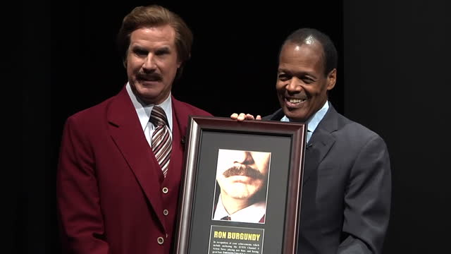 interior shots of ron burgundy, character from the movie anchorman accepting a plaque after the college announced it would name the school of... - cameo brooch stock videos & royalty-free footage