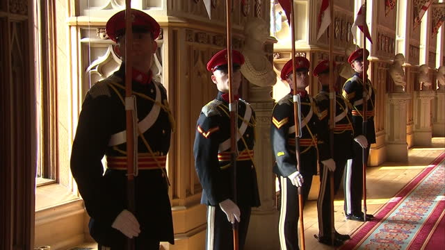 interior shots of royal lancers marching into windsor castle ahead of ceremony where the queen present them with a guidon on april 05 2017 in windsor... - windsor castle stock videos & royalty-free footage