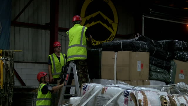 interior shots of royal new zealand air force personnel working in a warehouse, preparing crates of humanitarian aid to be sent to help residents of... - extreme weather stock videos & royalty-free footage