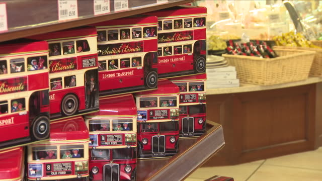 interior shots of royal themed food items for sale on the shelves of upscale london grocer partridges, including decorative biscuit tins featuring... - souvenir stock videos & royalty-free footage