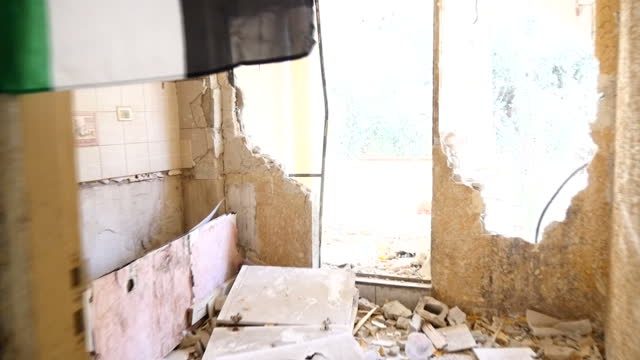 interior shots of rubble and damage inside the apartment of palestinian tram stop attacker abdel rahman shaloudi which was destroyed by israeli... - palestinian flag stock videos & royalty-free footage