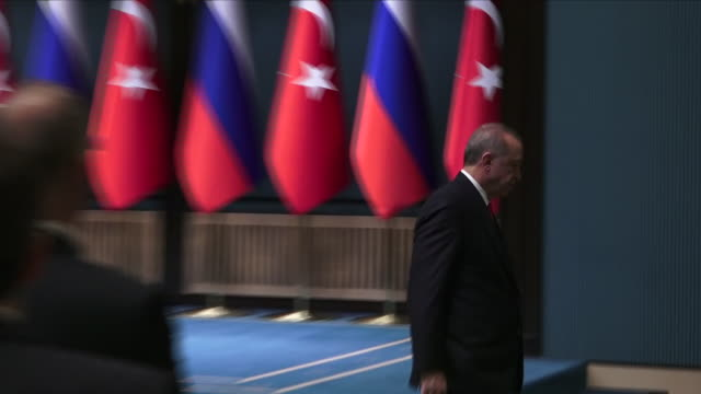 Interior shots of Russian President Vladimir Putin and Turkish President Recep Tayyip Erdogan walking to podiums in a joint press conference on 4...