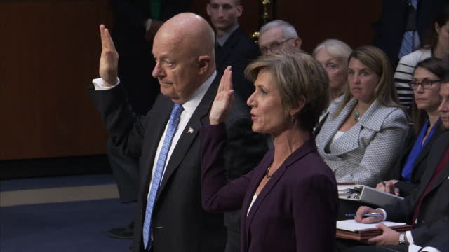 interior shots of sally yates former acting us attorney general and former national intelligence director james clapper being sworn in before giving... - eid stock-videos und b-roll-filmmaterial