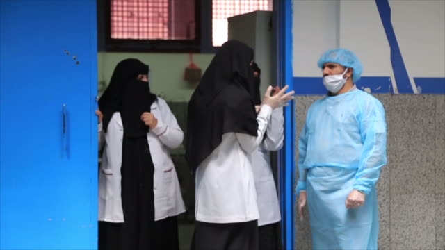 interior shots of sana'a hospital with medics wearing face masks and gown amid the coronavirus pandemic on 17 may 2020 in sana'a, yemen - yemen stock videos & royalty-free footage