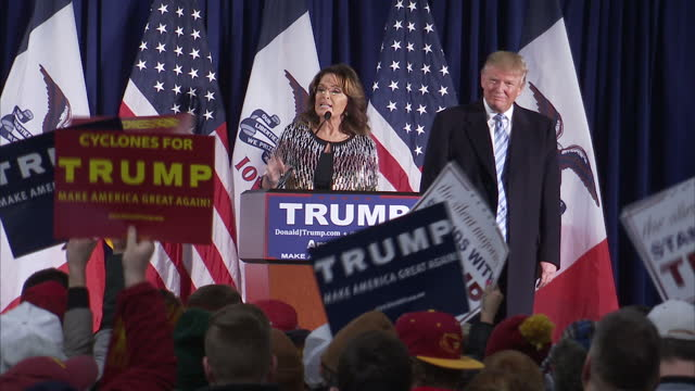 interior shots of sarah palin stood at podium speaking in support of donald trump with trump stood to one side on january 19 2016 in ames iowa - iowa stock videos & royalty-free footage