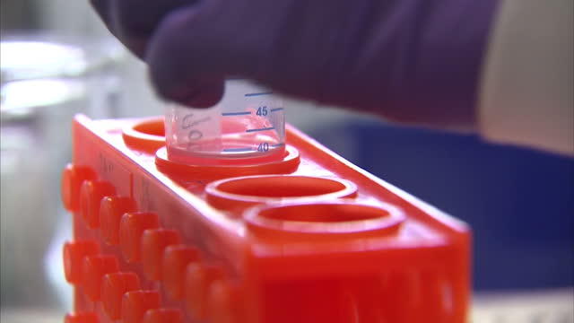 interior shots of scientists working in stem cell research lab on march 08 2016 in rugby england - stammzelle stock-videos und b-roll-filmmaterial