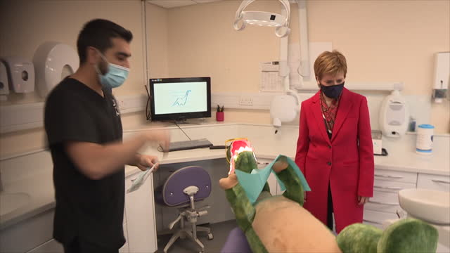 interior shots of scottish first minister nicola sturgeon msp talking to dentists on a visit to a dental surgery and performing 'dental work' on a... - dental hygiene stock videos & royalty-free footage