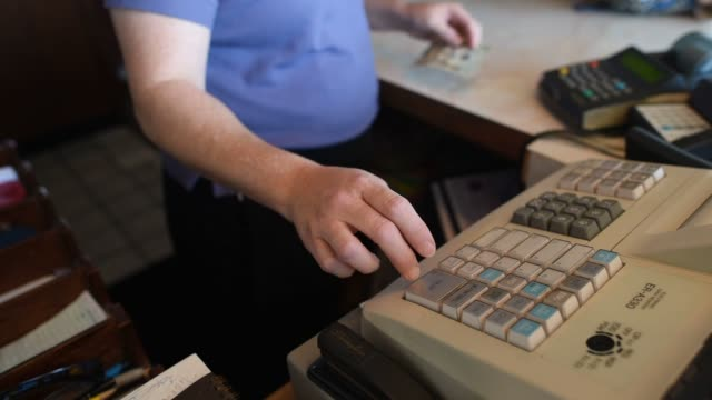 interior shots of service employees receiving payment from customers at a cash register inside the red apple family restaurant in princeton illinois... - waitress stock videos & royalty-free footage