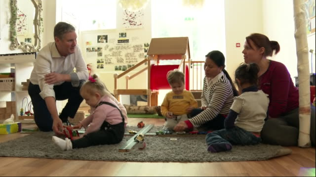 interior shots of shadow brexit secretary and labour leadership hopeful sir keir starmer mp meeting mothers with toddlers at a batley playgroup on 17... - nursery school building stock videos & royalty-free footage