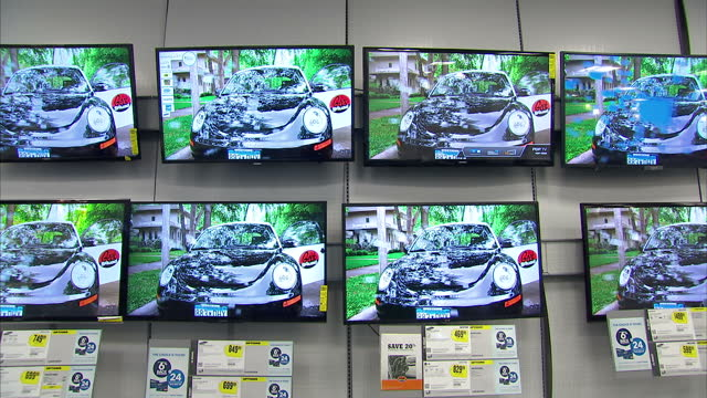 interior shots of shoppers and staff in a branch of best buy in times square new york with flatscreen tv's on sale on february 02 2014 in new york... - flat screen stock videos & royalty-free footage