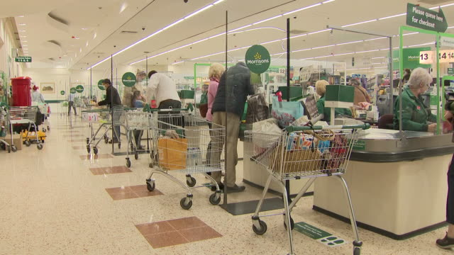 interior shots of shoppers with various bags at morrisons supermarket on 17th august 2020 in leeds united kingdom - paper bag stock videos & royalty-free footage