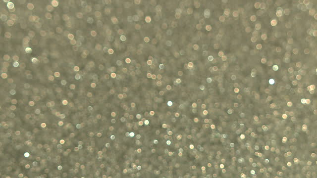 Interior shots of silver coloured glitter being sprinkled on a white surface on November 16 2017 in London England