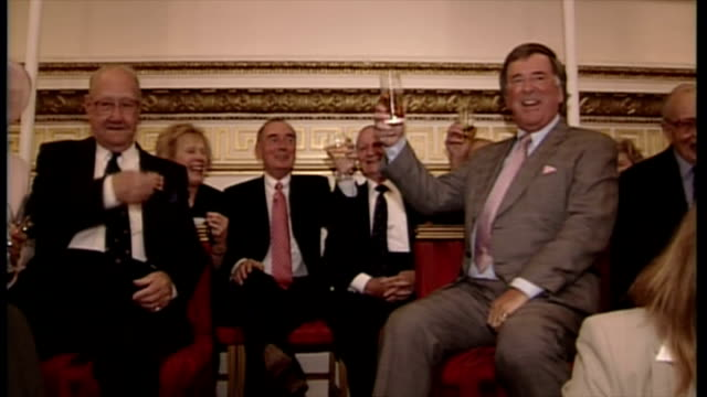 interior shots of sir terry wogan chatting with war veterans at charity event and raising glass for a toast on july 06 2005 in buckingham palace... - terry wogan video stock e b–roll