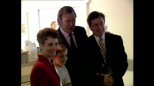 interior shots of sir terry wogan talking to staff and posing for photos with children during an event at st mary's hospital on april 22 1997 in... - terry wogan video stock e b–roll