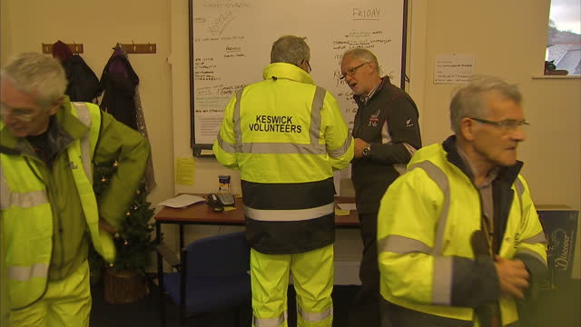 interior shots of soldiers from duke of lancaster's regiment walking into flood control room in keswick and looking at maps of local area in command... - regiment stock videos and b-roll footage