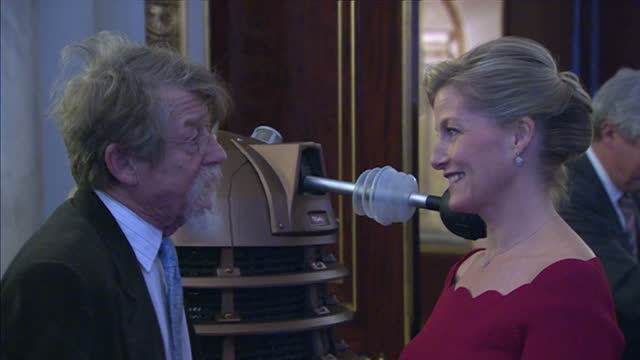 interior shots of sophie countess of wessex being shown a dalek and meeting actor john hurt who will appear in the special 50th anniversary episode... - doctor who stock videos & royalty-free footage