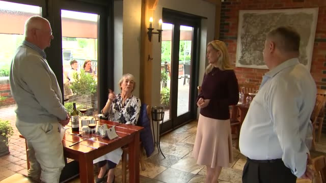 interior shots of sophie countess of wessex visiting her local pub the half moon and talking to the landlord staff and customers on 8 july 2020 in... - half moon stock videos & royalty-free footage