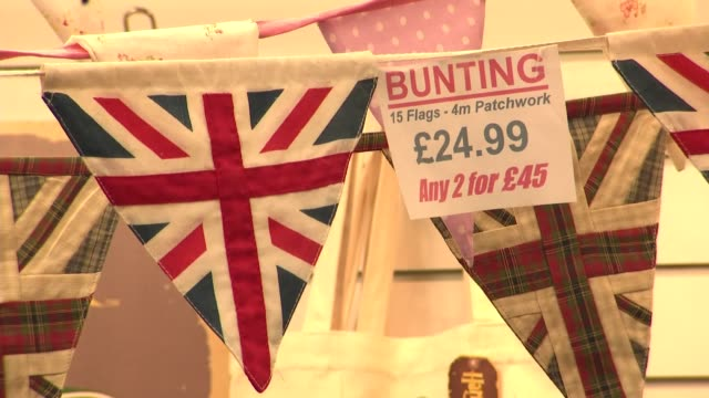 stockvideo's en b-roll-footage met interior shots of souveniers on sale on a stand in the bath guildhall market including postcards of bath and union jack branded items on 3 may 2019... - sale