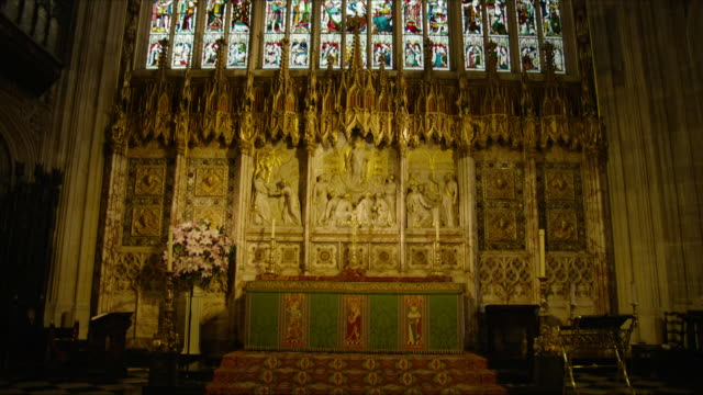 interior shots of st george's chapel including shots of the stained glassed windows and wall carvings prince harry and meghan markle's wedding... - chapel stock videos & royalty-free footage