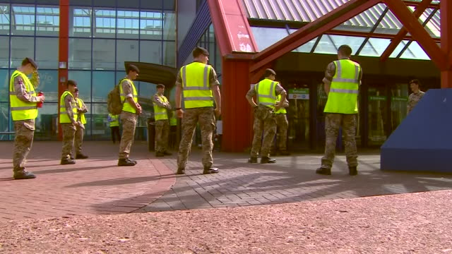 interior shots of staff working to construct wards and exterior shots of the military outside of the nec building as it is repurposed as a nhs... - armed forces stock videos & royalty-free footage