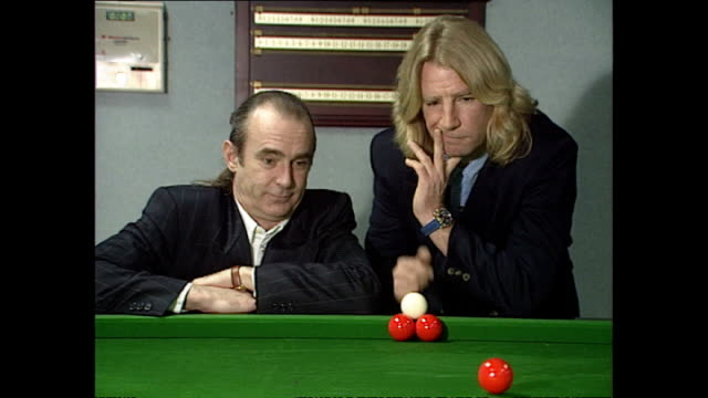 interior shots of status quo's rick parfitt and francis rossi posing behind snooker table in promotion of their auto biography on november 10 1993 in... - biography stock videos & royalty-free footage