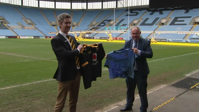 interior shots of stephen vaughan and dave boddy posing for pictures while holding coventry and wasp shirts in the ricoh arena. - coventry stock videos & royalty-free footage