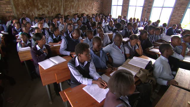 interior shots of students taking a lesson in a classroom at mapeloana high school in limpopo. exterior shots of the school building & pupils walking... - south africa stock videos & royalty-free footage