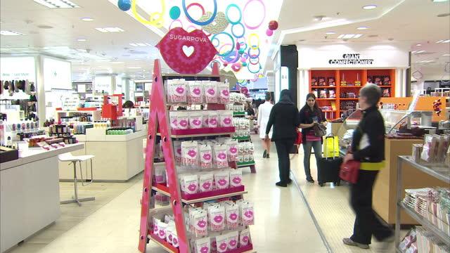 vídeos de stock, filmes e b-roll de interior shots of sugarpova sweets on sweet stands in selfridges central london after maria sharapova personally launched them instore maria... - maria sharapova
