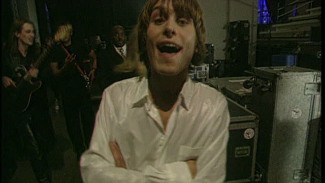 interior shots of take that's mark owen walking from brit awards saying 'that's all folks' to camera on 19 february 1996 in london, united kingdom - pop musician stock videos & royalty-free footage