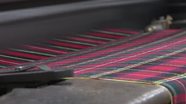 interior shots of tartan cloth being woven on a loom at a mill on march 16 2017 in edinburgh scotland - tartan stock videos & royalty-free footage