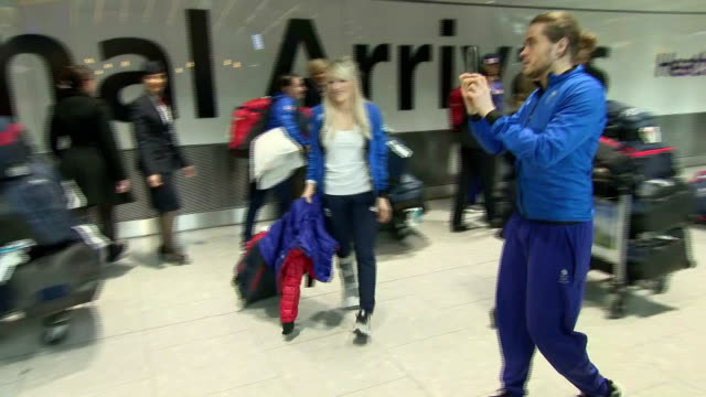 Interior shots of Team GB Winter Olympians walking with luggage upon arrival at Heathrow Airport including among others Elise Christie and Lizzie...