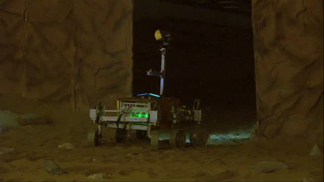 Interior shots of the Airbus ExoMars 'Bridget' rover exploring a simulated Martian cave environment operated by British astronaut Tim Peake via...