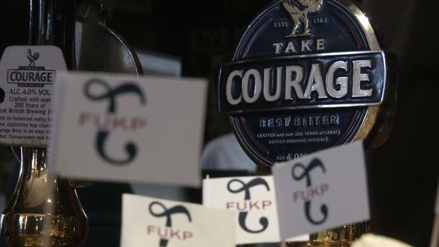 interior shots of the bar area of the new inn in sandwich, with beer pumps and sandwiches left out on bar with 'fukp' flags to launch al murray's... - al murray stock videos & royalty-free footage