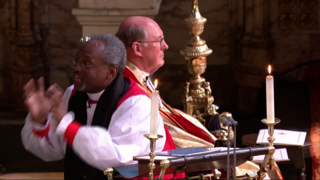interior shots of the bishop michael curry's speech from the royal wedding of prince harry and meghan markle with cutaways to the royal couple and... - clip stock-videos und b-roll-filmmaterial