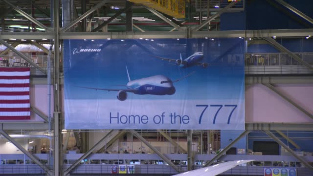 interior shots of the boeing everett factory in everett washington pan of the factory floor with multiple planes being assembled shots of various... - boeing stock videos & royalty-free footage