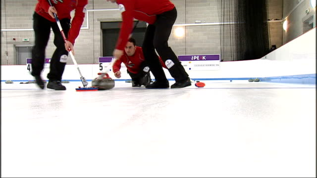 interior shots of the british men's curling team curling on ice men's team players standing on ice talking posing for photo opportunity british men's... - bobsleighing stock videos & royalty-free footage