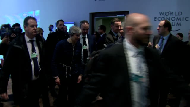 interior shots of the british prime minister theresa may walking through lobby of the world economic furum convention. on january 25, 2018 in davos,... - prime minister stock videos & royalty-free footage