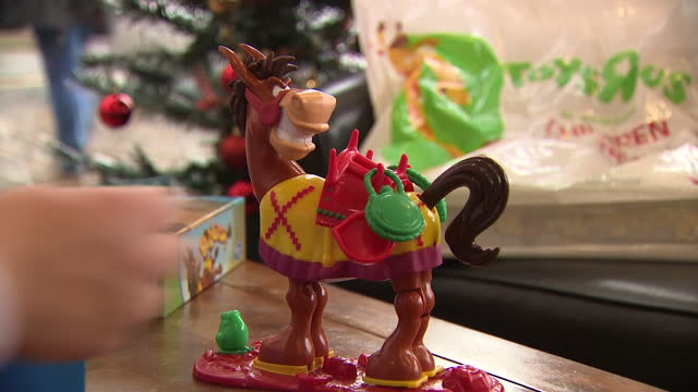 interior shots of the children's game buckaroo showing a hand placing game pieces on the model burro and the buckaroo burro bucking the pieces off on... - leisure games stock videos & royalty-free footage